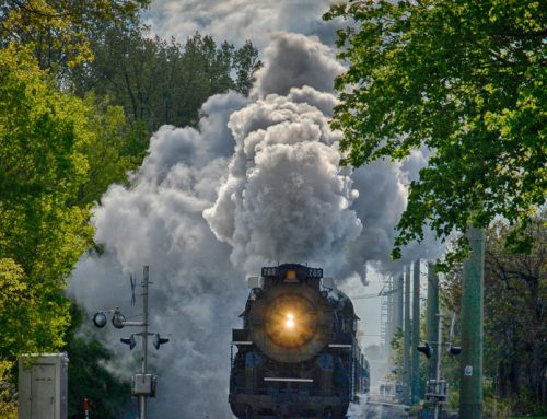 Staff member dodges locomotive to get the perfect shot